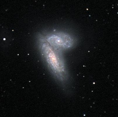 Billede af to galakser tæt op ad hinanden.