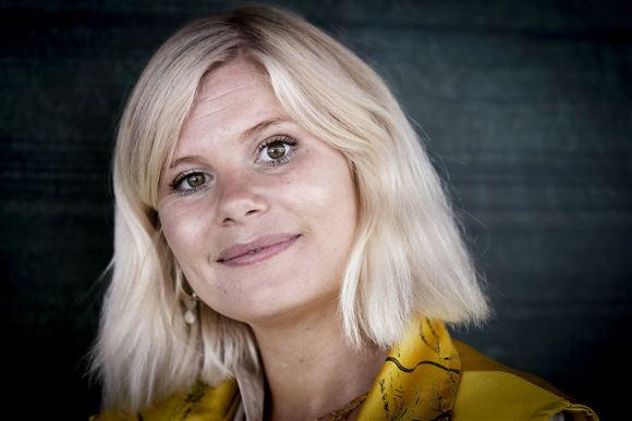 Portrætbillede af en smilende Sofie Linde