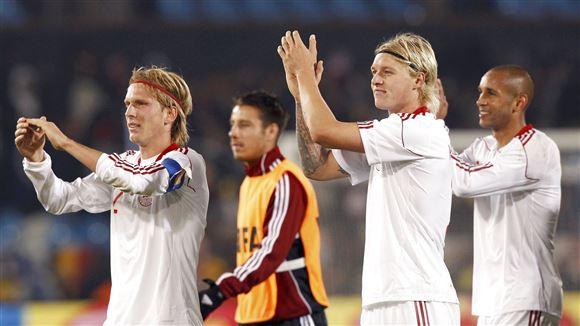 Christian Poulsen ses sammen med landsholdkolleger
