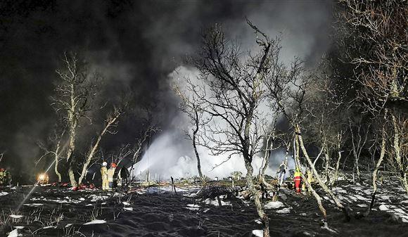 billede af den nedbrændte hytte
