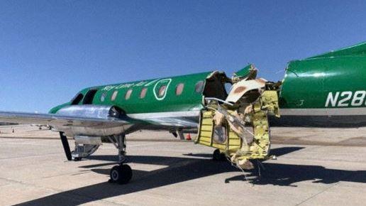 grønt fly med store skader på skroget
