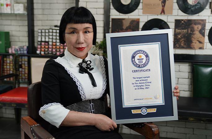 You Jianxia holder sit rekordbevis