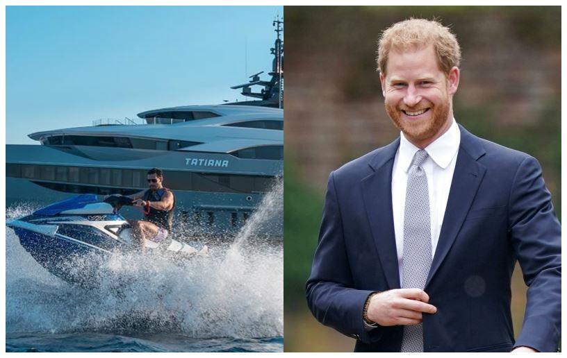 En kæmpe yacht og en smilende rødhåret mand